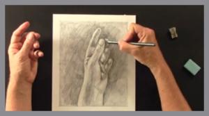 kreslí tužkou svou ruku