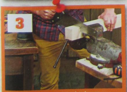 muž řeže dřevo při výrobě pelíšku pro psa