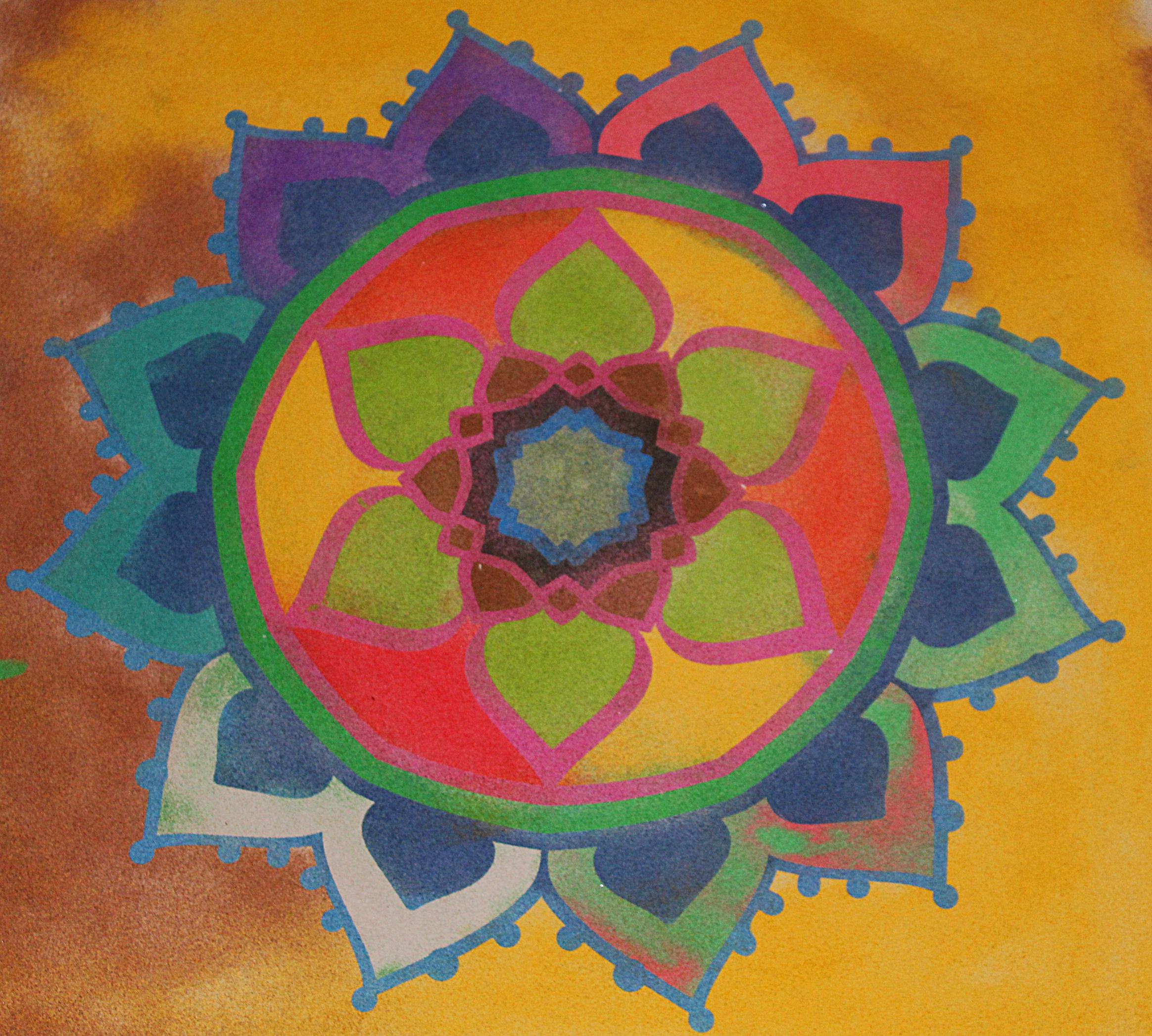 Obrázek mandaly vybarvené barevným pískem